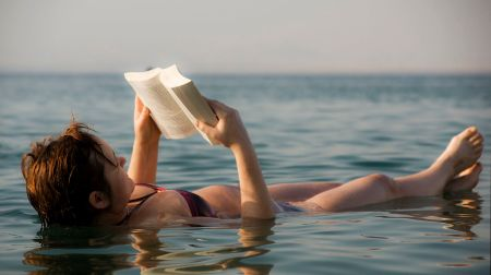 1280px-the_dead_sea_-_woman_reading_a_book